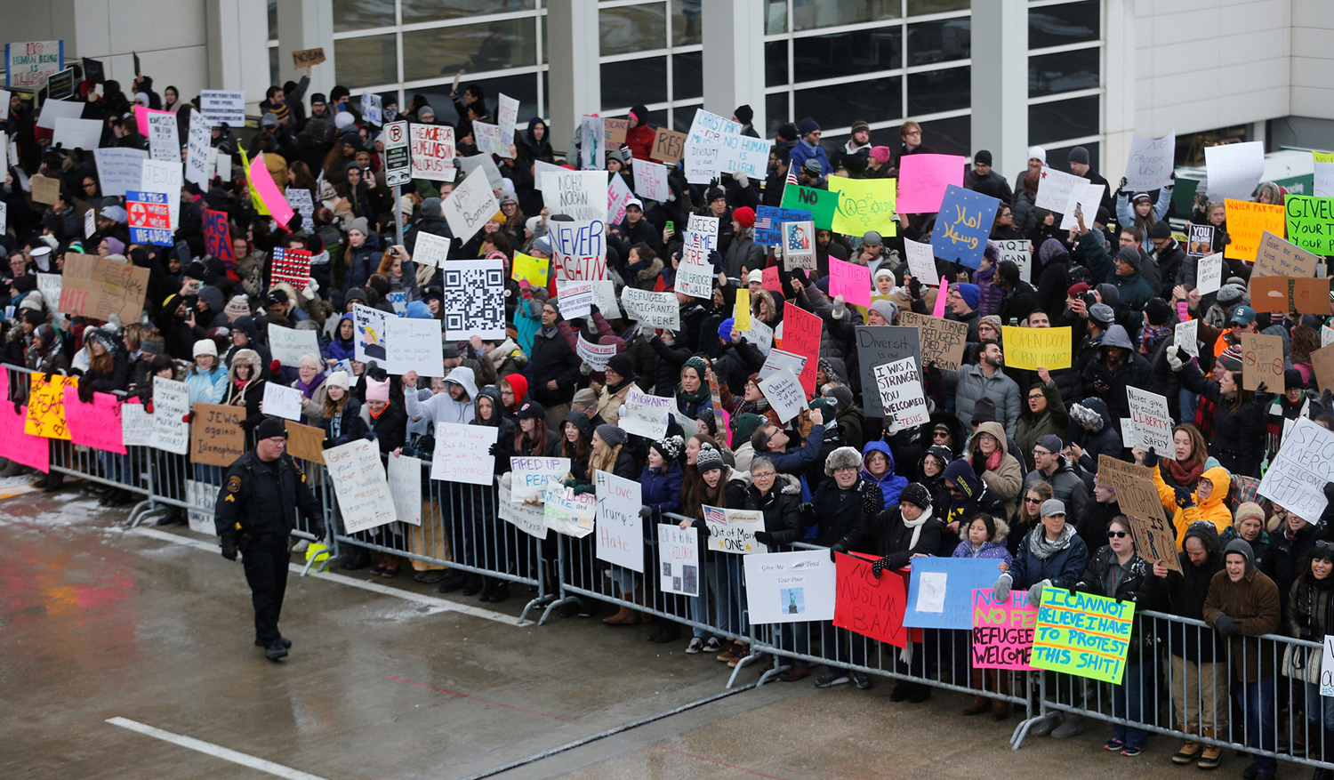 Hundreds of people rally against the temporary travel ban during a protest at Detroit Metropolitan airport in Romulus, Michigan, on January 29, 2017.
